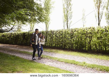 Mixed race couple with daughter walking in the countryside