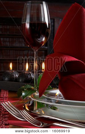 Christmas dinner table detail with red and black accents