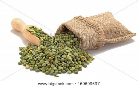 Green peas in a burlap with a shovel. Isolated