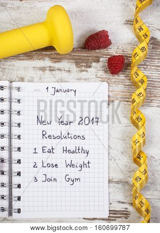 New Year Resolutions Written In Notebook On Old Board