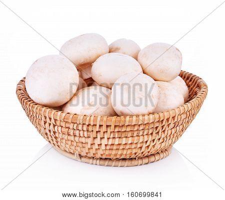 Agaricus bisporus mushrooms basket on white background