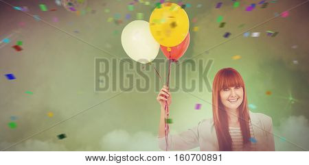 Smiling hipster woman holding balloons against smoke at illuminated disco
