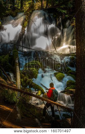 Hiker Looking At Clearwater Falls Oregon Vertical Composition