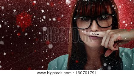 Happy smiling hipster with a mustache against snow