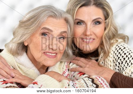 Portrait of two smiling senior and mature women looking at the camera