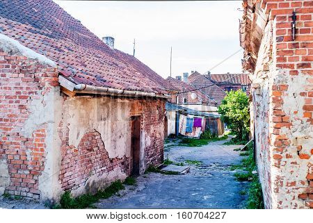 Yantarny, Russia - June 22, 2010: Colorful linen dry on rope in old house yard