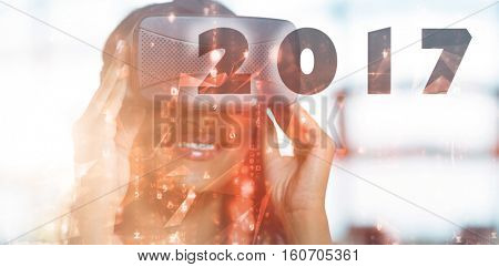 Digital image of new year 2017 against abstract background