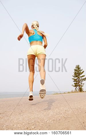rare view of running woman in nature outdoors