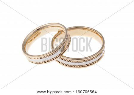 Golden wedding rings isolated on white background