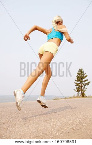 woman training near water in nature outdoors