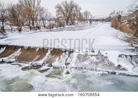 one of numerous water diversion  dams on the Poudre River - aerial view of winter scenery