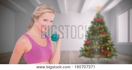 Happy fit woman against home with christmas tree