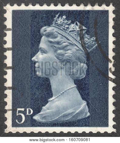 MOSCOW RUSSIA - NOVEMBER 2016: a post stamp printed in the UNITED KINDOM shows a portrait of Portrait of Queen Elizabeth II circa 1970 - 1977