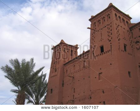 Moroccan Fortress With A Plam Tree, Ait Benhaddou Ksar, Ouarzazate, Morocco