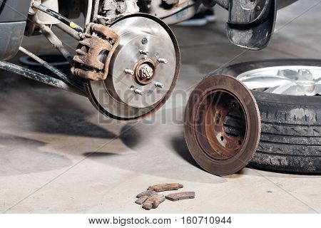 brake disc. Replacement of the old to the new. Auto mechanic repairing