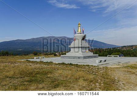 View of  Buddhist stupa Sofia in the Retreat Center Plana - Diamondway Buddhism Bulgaria near by Vitosha, Rila, Pirin, and Balkan mountains  from  distance