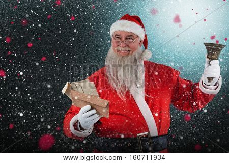 Santa Claus holding envelope and bell against snow with red flakes