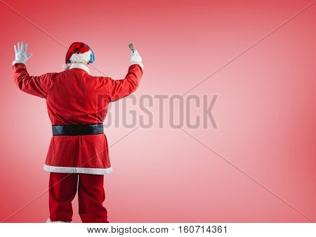 Rear view of santa claus standing against red background
