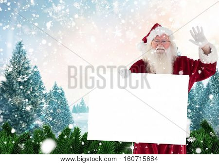 Santa claus waving while holding blank placard against digitally generated background