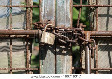 Metal Gate Locked With Chain And Padlock