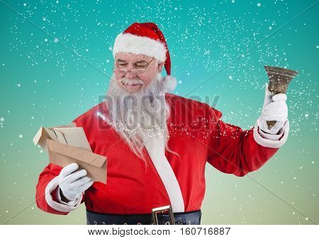 Santa holding bell and reading christmas letters against digitally generated snowy background