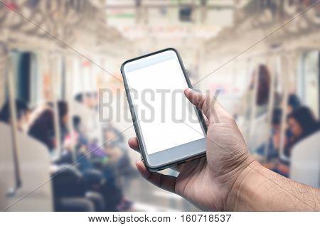 hand hold blank screen smartphone in train.