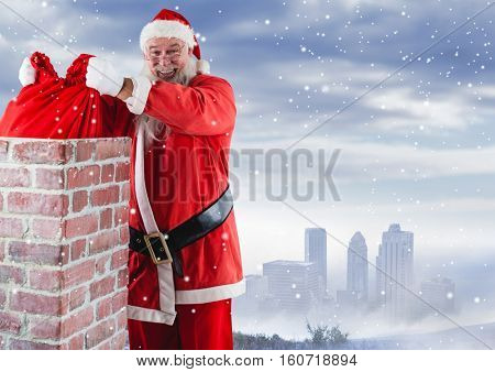 Santa removing gift sack from chimney against digitally generated snow background