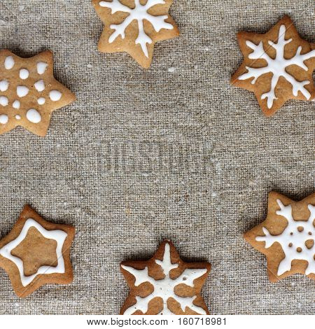 flat lay figure cookies on woven fabrics of flax top view / appetizing frame of delicious stars
