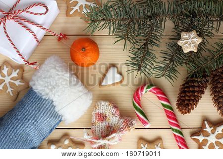 flat lay of the various objects on the festive light wooden surface top view / Merry Christmas and Happy New Year
