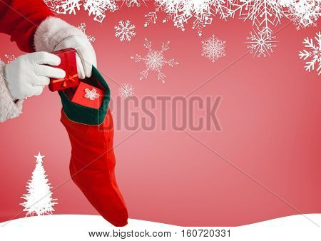Santa claus putting gifts in christmas stockings against christmas background