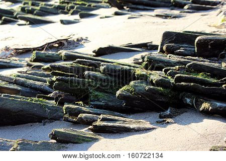 ancient historic wooden platform on the bank of the Northern Dvina River, for rafts of logs collected for timber floating drift.