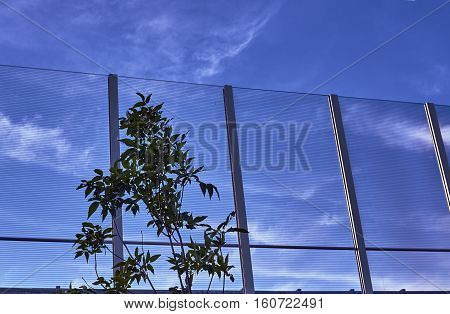 Transparent baffle against the blue sky in Poland