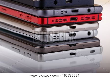 Pile of mobile phone. Heap of the different smartphones on white background.