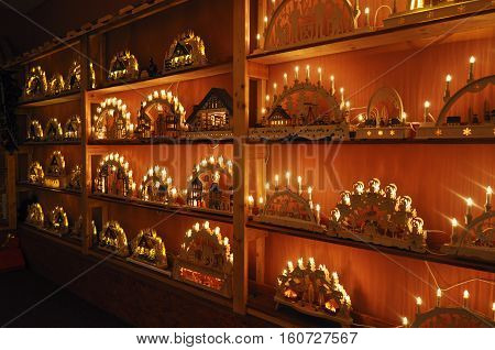 Goerlitz,Germany - October 15, 2015: Shop Interior with Christmas toys. Arched carved wooden candle holders with light. National German craft. Goerlitz, Saxony, Germany.