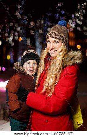Mother and son in new year on street at night