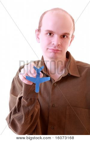 Photo of businessman holding paper aircraft