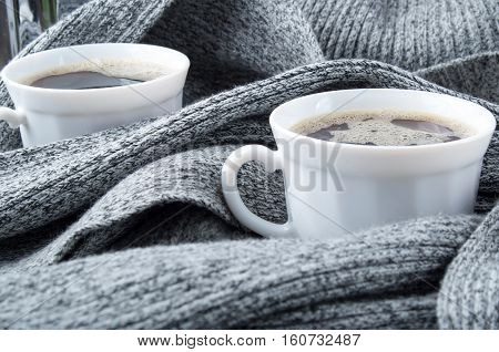 Two White Cups Of Coffee Wrapped In Scarf