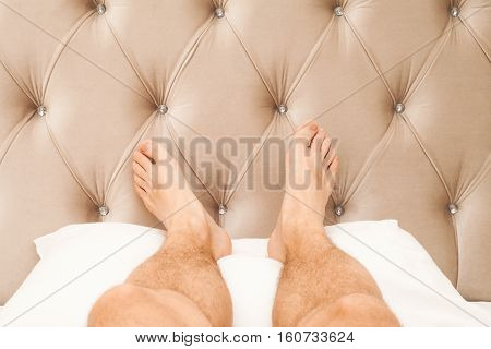 Relaxing Male Feet Lay On White Pillow