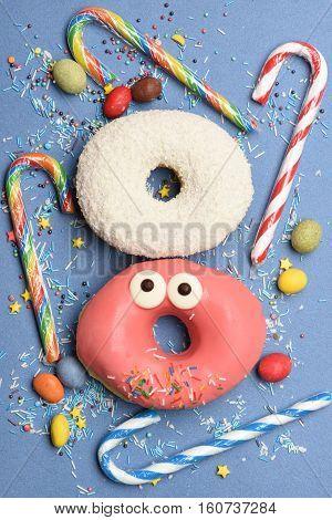 Funny Glazed Donuts On Blue Background