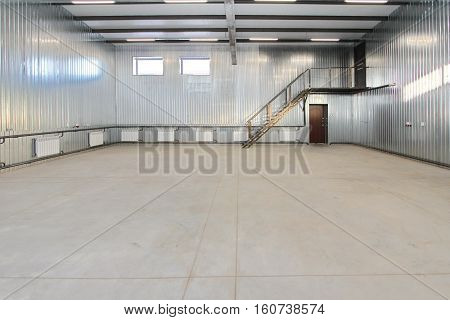Empty Parking Garage, Warehouse Interior With Large White Gates And Windows Inside