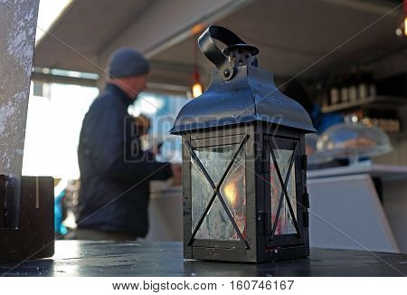 Lantern with candle and light, sundown in the mountains on the background