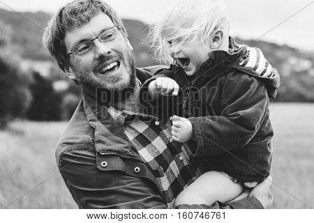 Family Father Son Smiling Togetherness Outdoors Carrying Concept