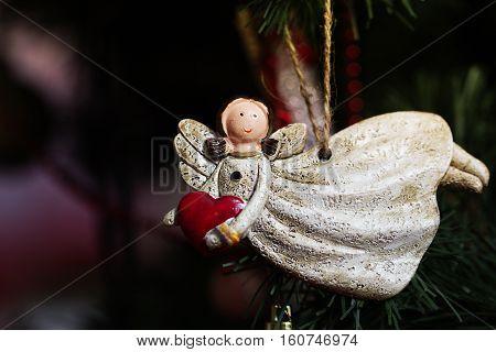 toy on the Christmas tree Christmas angel. ornaments and symbols of Christmas