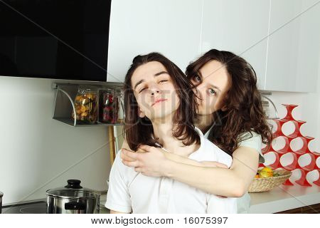 Cute woman with arm around a man