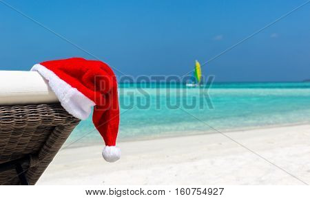 Closeup of Christmas hat on a sunbed at a tropical beach