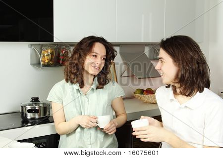 Happy couple in their kitchen