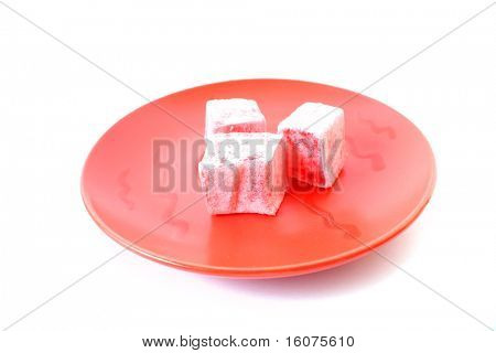Turkish delight lokum confection on a white dessert plate