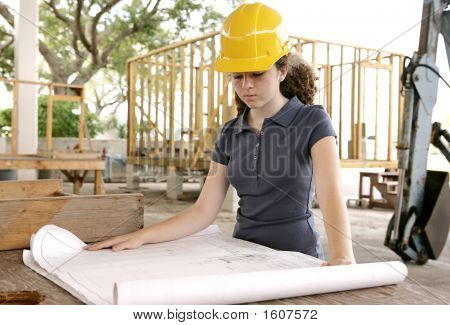 Engineering Student Reads Blueprints