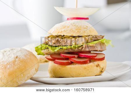 Sandwich with roast beef, lettuce and radish