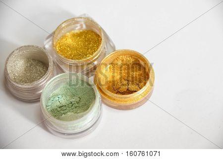 Gold Glitter, Shiny Eyeshadows. Brilliant Glitter Nail Design On A White Background